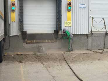 Sand and soda blasting masonry buildings